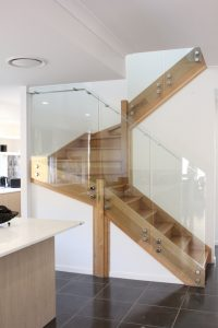 glass staircase with standoffs